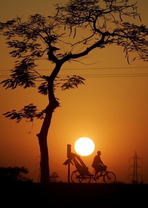 Skurrile Reisefotos, lustige Bilder Kategorie Reise: Rikschafahrer im Sonnenuntergang
