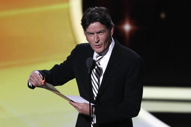 Presenter Sheen announces the winner of the award for outstanding lead actor in a comedy series at the 63rd Primetime Emmy Awards in Los Angeles
