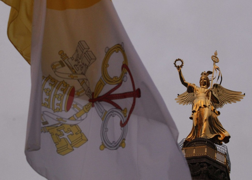 The Vatican Flag is pictured near the Siegessaeule (Victory Column) in Berlin