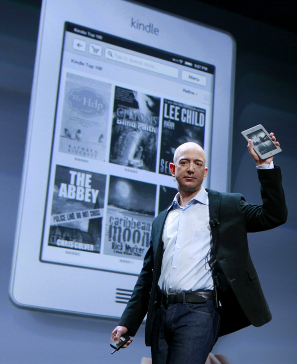 Amazon CEO Jeff Bezos holds up the new Kindle Touch at a news conference during the launch of Amazon's new tablet in New York