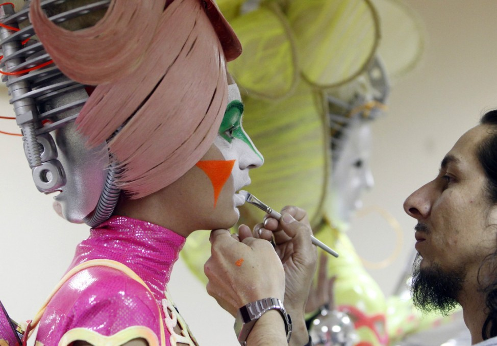 A model gets made up before the Alternative Hair Show in Moscow's Kremlin