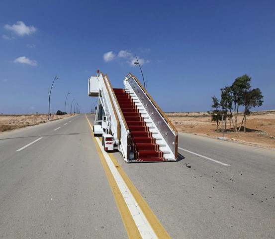 Abandoned VIP stairway is seen on a road at the airport in Sirte