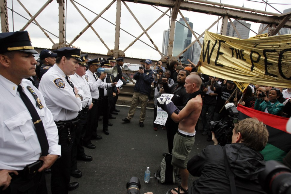 Police square off against protesters on the Brooklyn Bridge during an Occupy Wall Street march in New York