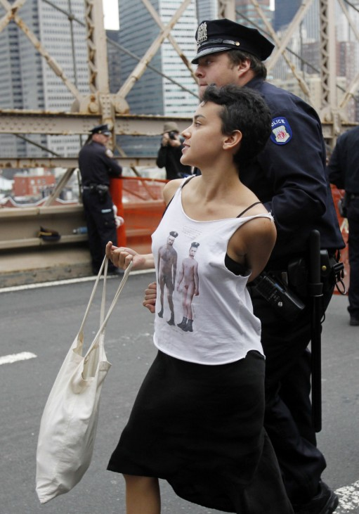 A protester reacts as she is arrested on the Brooklyn Bridge during an Occupy Wall Street march in New York