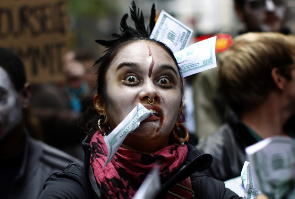 Occupy Wall Street protestors dressed as 'corporate zombies' march during a demonstration in New York