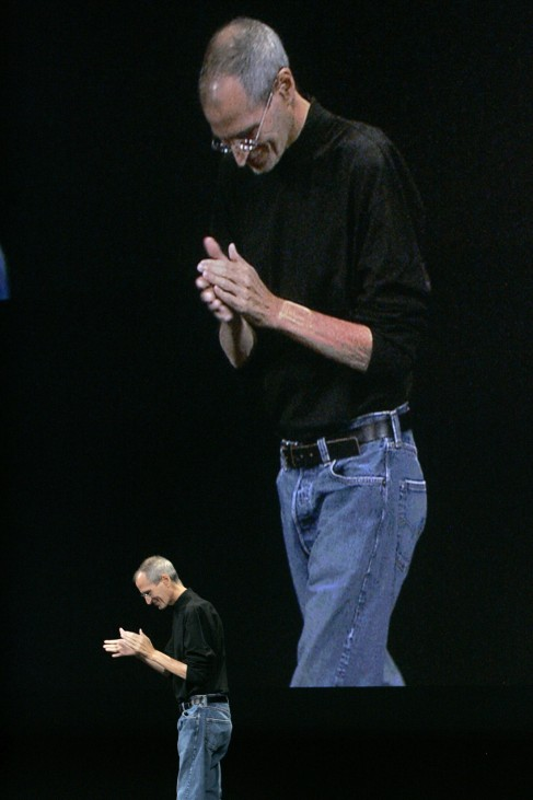 File photo of Apple Inc. Chief Executive Steve Jobs clapping as he walks offstage of a special event in San Francisco, California