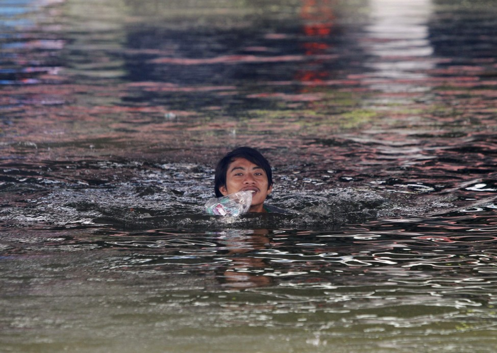 Man makes his way through the flooded area of Ayutthaya province