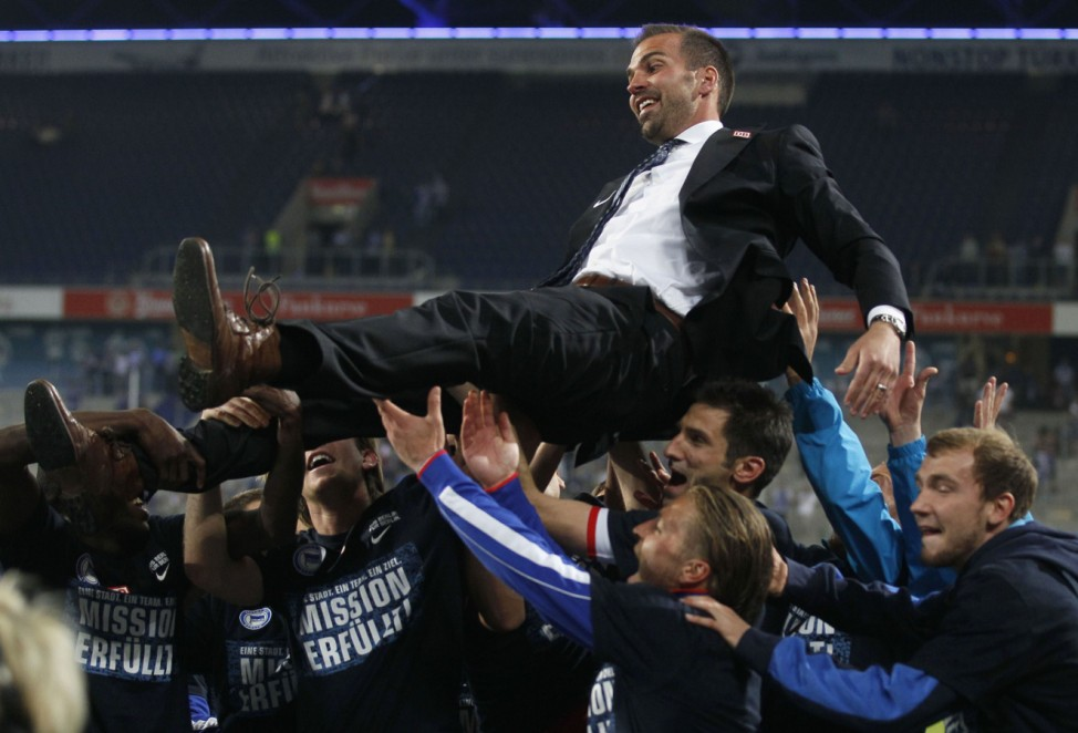 Hertha Berlin's coach Babbel is carried by his players following their German Bundesliga second division soccer match against MSV Duisburg in Duisburg