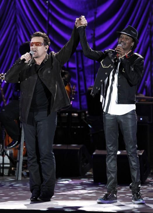 Bono, lead singer of Irish band U2, and Somali-Canadian musician K'naan perform at the Hollywood Bowl in Hollywood