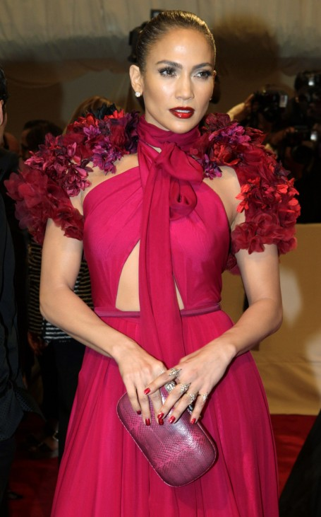 Singer Jennifer Lopez poses on arrival at the Metropolitan Museum of Art Costume Institute Benefit celebrating the opening of Alexander McQueen: Savage Beauty in New York