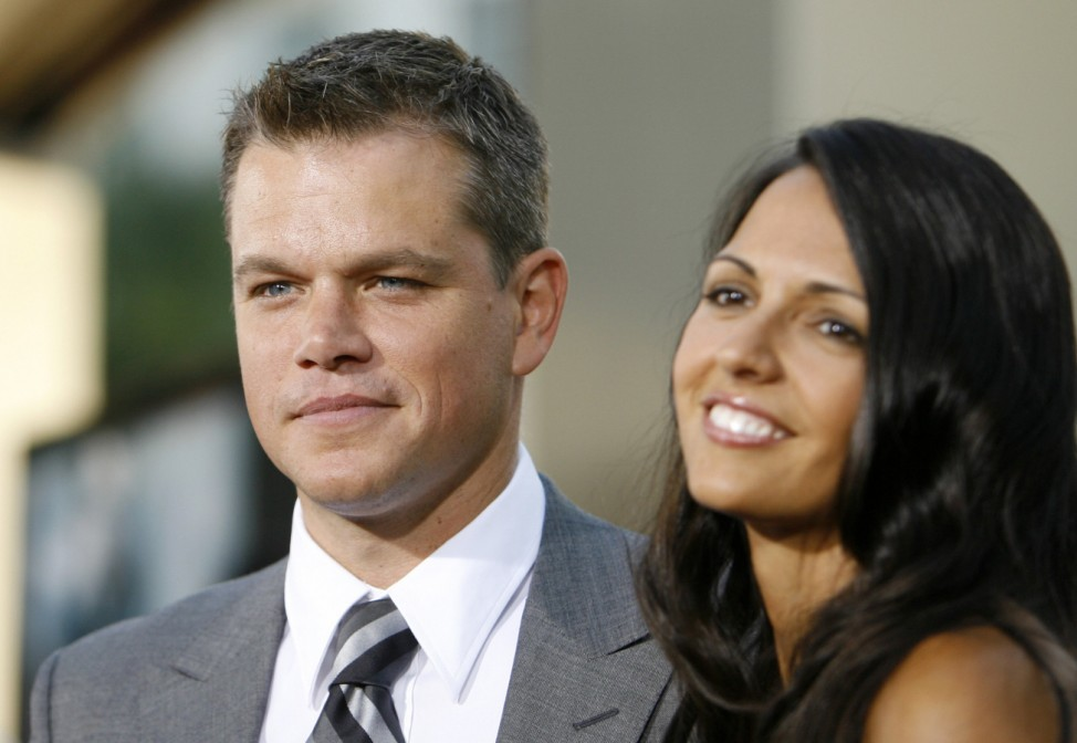 Actor Matt Damon poses with his wife Luciana Barroso at the premiere of 'The Bourne Ultimatum' at the Arclight in Hollywood