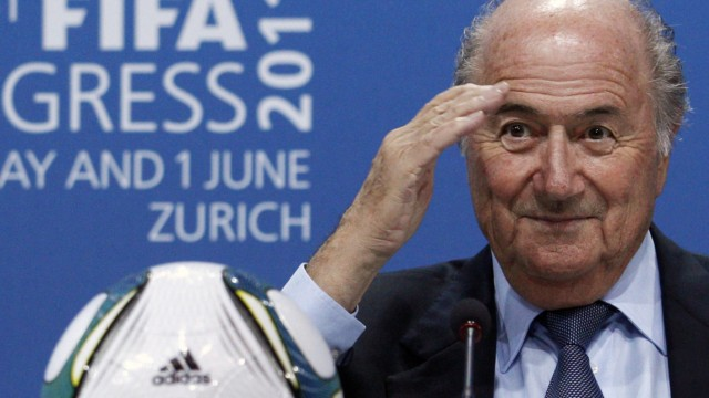 FIFA president Blatter gestures during a news conference after being re-elected for a 4th term as president in Zurich