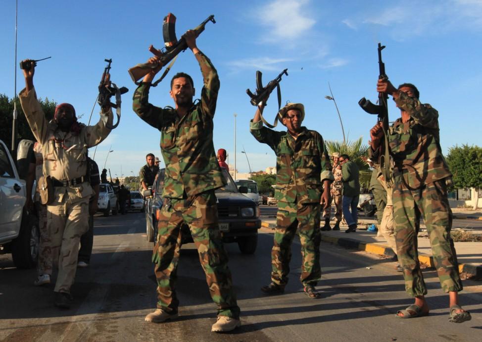Anti-Gaddafi fighters celebrate in Sirte