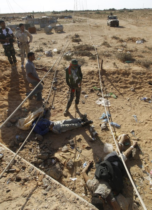 Dead anti-Gaddafi fighters are seen dead near the drain where Muammar Gaddafi was hiding before he was captured in Sirte