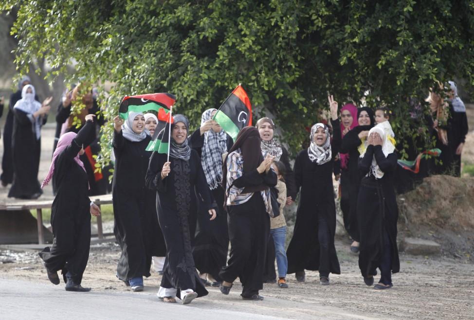 Libyans wave Kingdom of Libya flags as they celebrate the fall of Muammar Gaddafi in Misrata