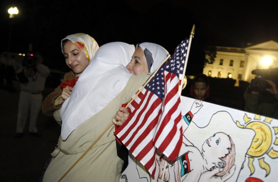 Libyans gather in front of the White House to celebrate the death of Muammar Gaddafi, in Washington