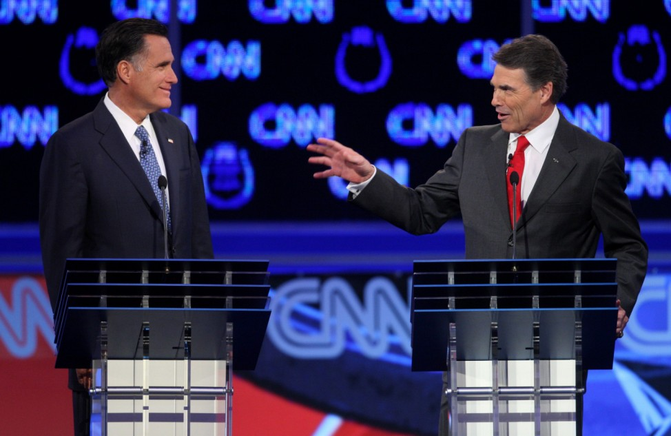 Republican presidential candidates Romney and Perry take part in the CNN Western Republican presidential debate in Las Vegas