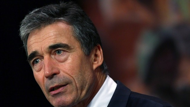 NATO Secretary-General Rasmussen speaks during a news conference in Brussels