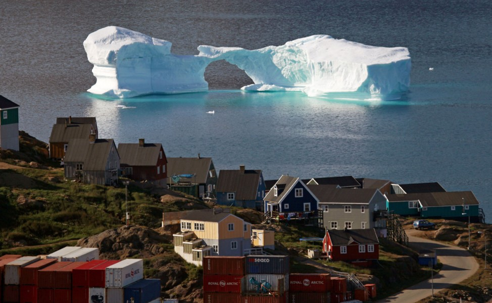 An iceberg floats near a harbour in the town of Kulusuk, east Greenland