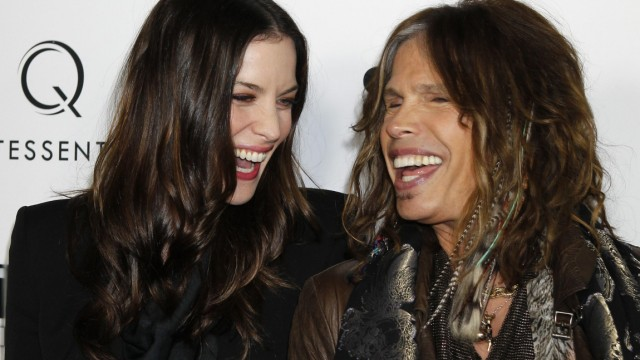 Actress Liv Tyler arrives for the premiere of her new film 'Super' with her father, musician Steven Tyler, in Hollywood