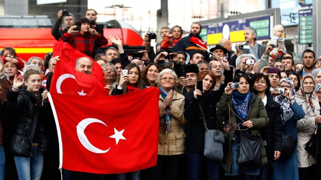Spectators await the arrival of a train from Istanbul celebrating the 50th anniversary of Turkish migrant workers agreement between Turkey and Germany in Munich