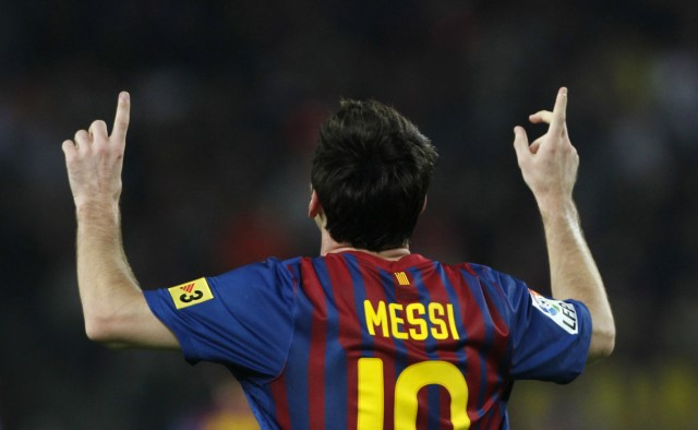 Barcelona's Lionel Messi celebrates his third goal against Mallorca during their Spanish First division soccer league match at Camp Nou stadium in Barcelona