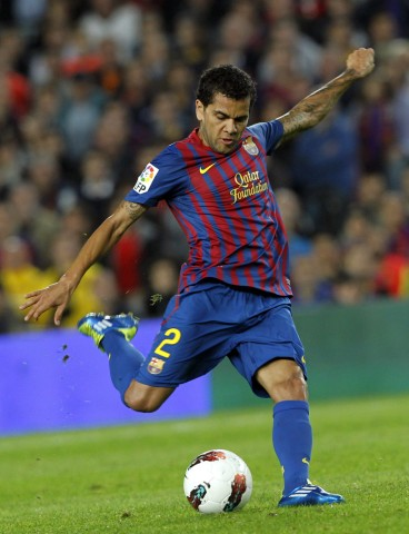 Barcelona's Alves kicks the ball against Sevilla during their Spanish first division soccer league match in Barcelona
