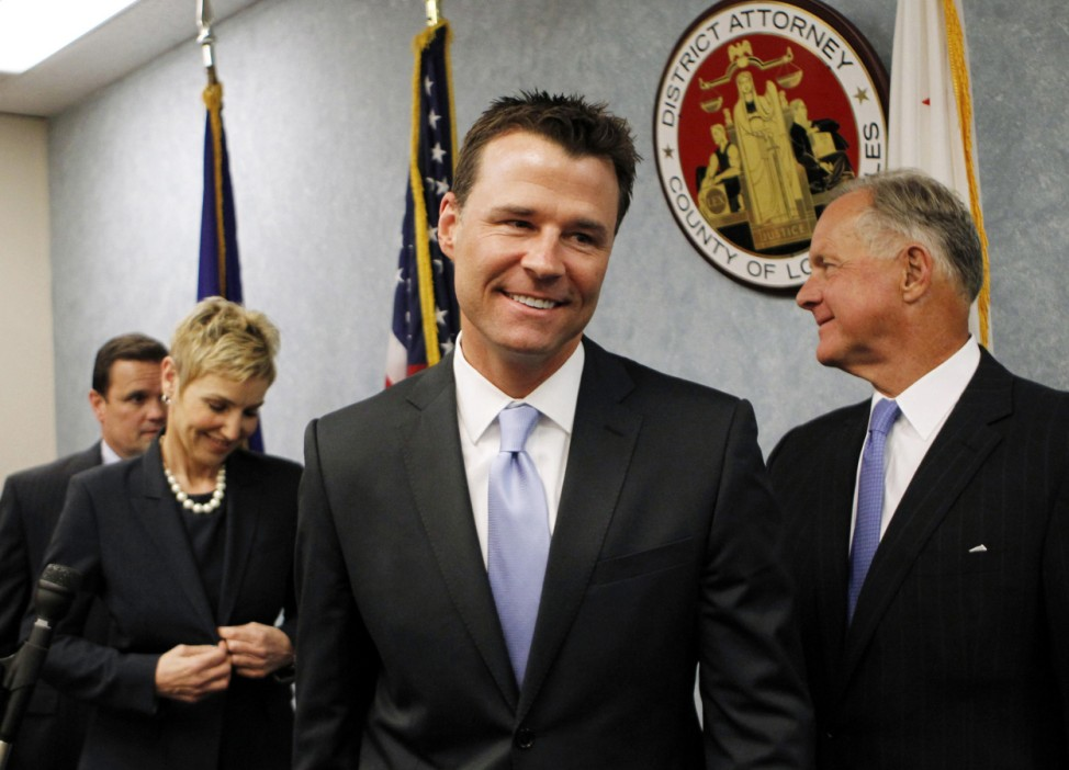 Deputy District Attorney Walgren and Deputy District Attorney Brazil smile as they leave a news conference in Los Angeles