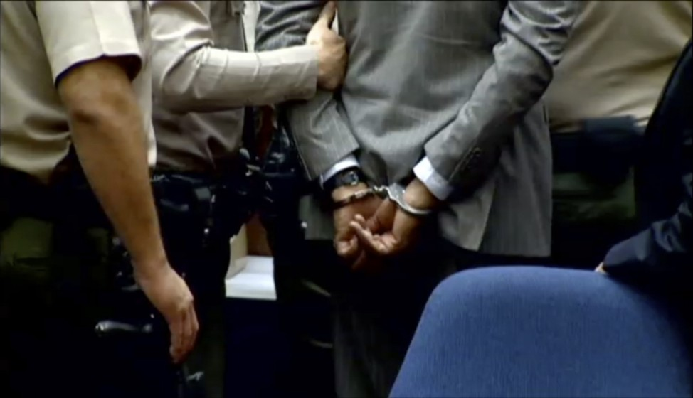 Dr. Conrad Murray is led away in handcuffs in Los Angeles
