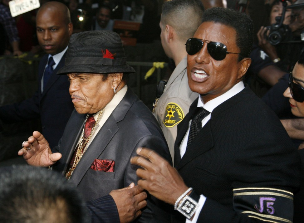 Joe Jackson and Jermaine Jackson leave the courthouse after the reading of the guilty verdict in Dr. Conrad Murray's trial in Los Angeles