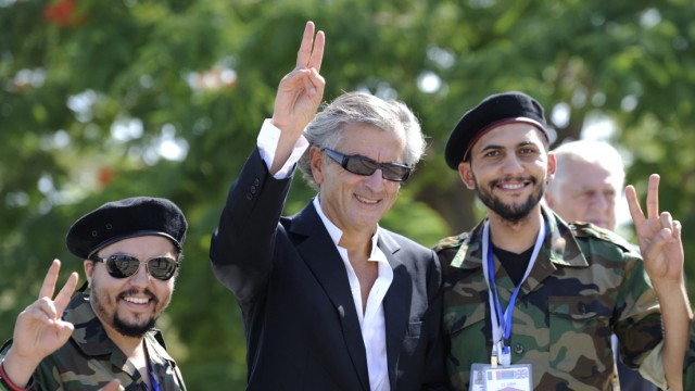 French philosopher Bernard-Henri Levy poses with a pro-National Transitional Council (NTC) combatant at the Tripoli Medical Center