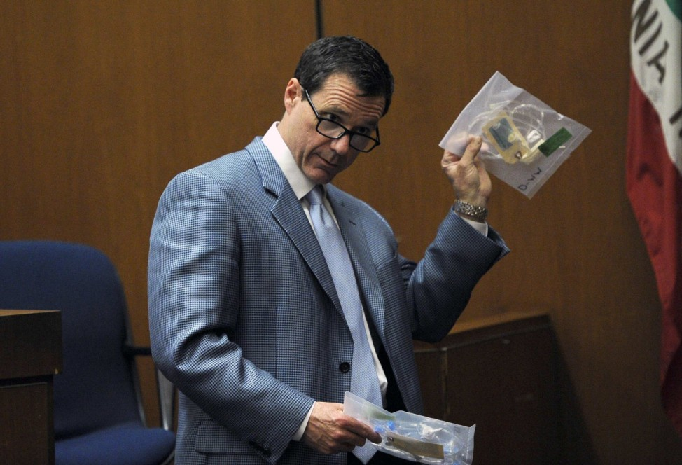 Ed Chernoff  holds up evidence as he makes his closing arguments in Dr. Conrad Murray's trial in the death of pop star Michael Jackson in Los Angeles