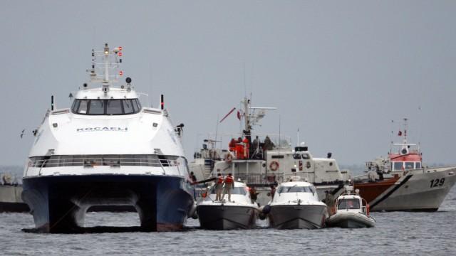 Passengers disembark from the hijacked 'Kartepe' ferry in Marmara sea off the northwestern Turkish town of Silivri, near Istanbul