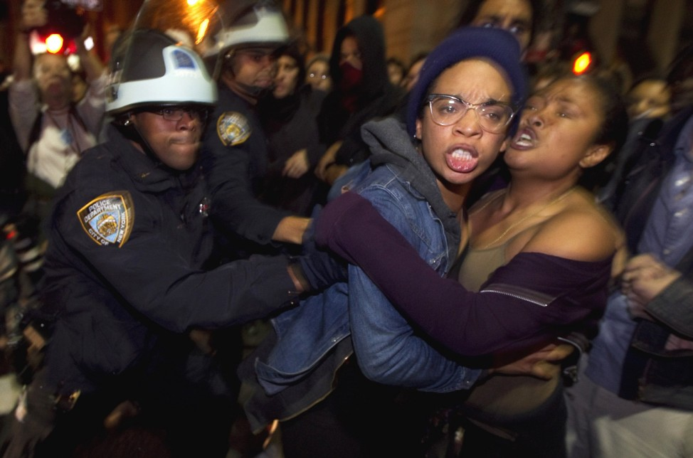Members of the Occupy Wall St movement clash with New York Police Department officers after being removed from Zuccotti Park in New York
