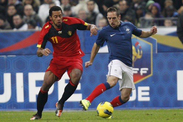 France's Ribery challenges Belgium's Dembele during their international friendly soccer match in Saint-Denis