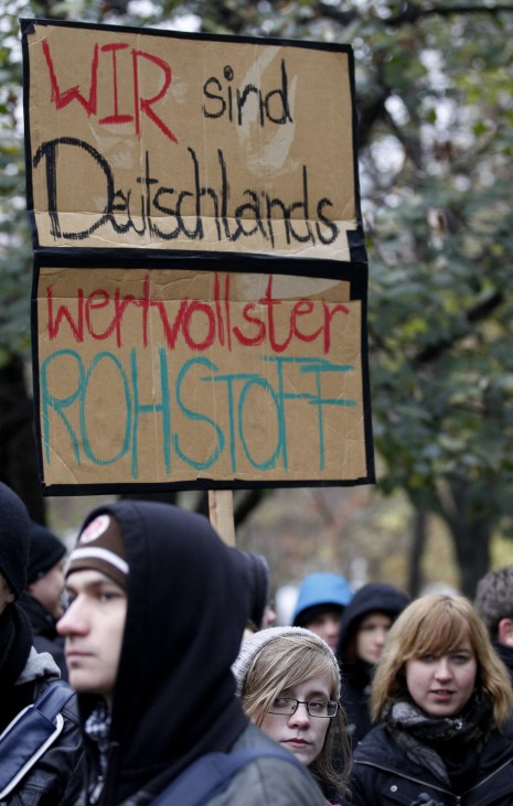 Girl carries banner during demonstration in Berlin