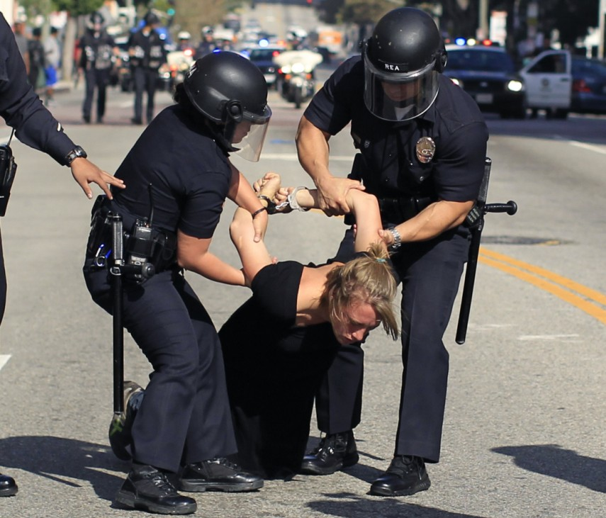 Police arrest a woman at an Occupy LA protest in Los Angeles