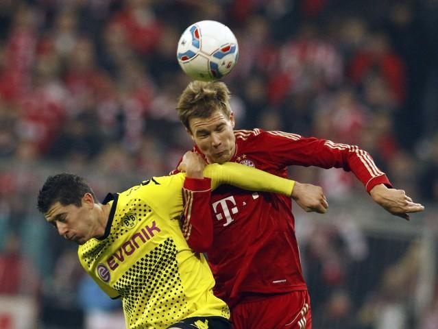 Munich's Badstuber is challenged by Dortmund's Lewandowski during their German Bundesliga soccer match in Munich