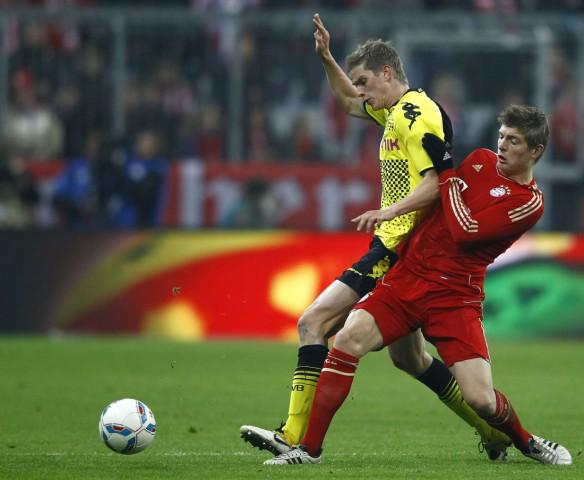 Kroos of Bayern Munich challenges Bender of Borussia Dortmund during their German first division Bundesliga soccer match in Munich