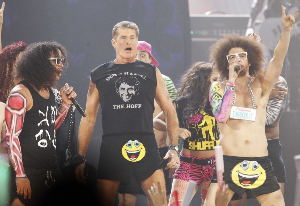 Actor David Hasselhoff performs with SkyBlu and DJ Redfoo of pop group LMFAO at the 2011 American Music Awards in Los Angeles