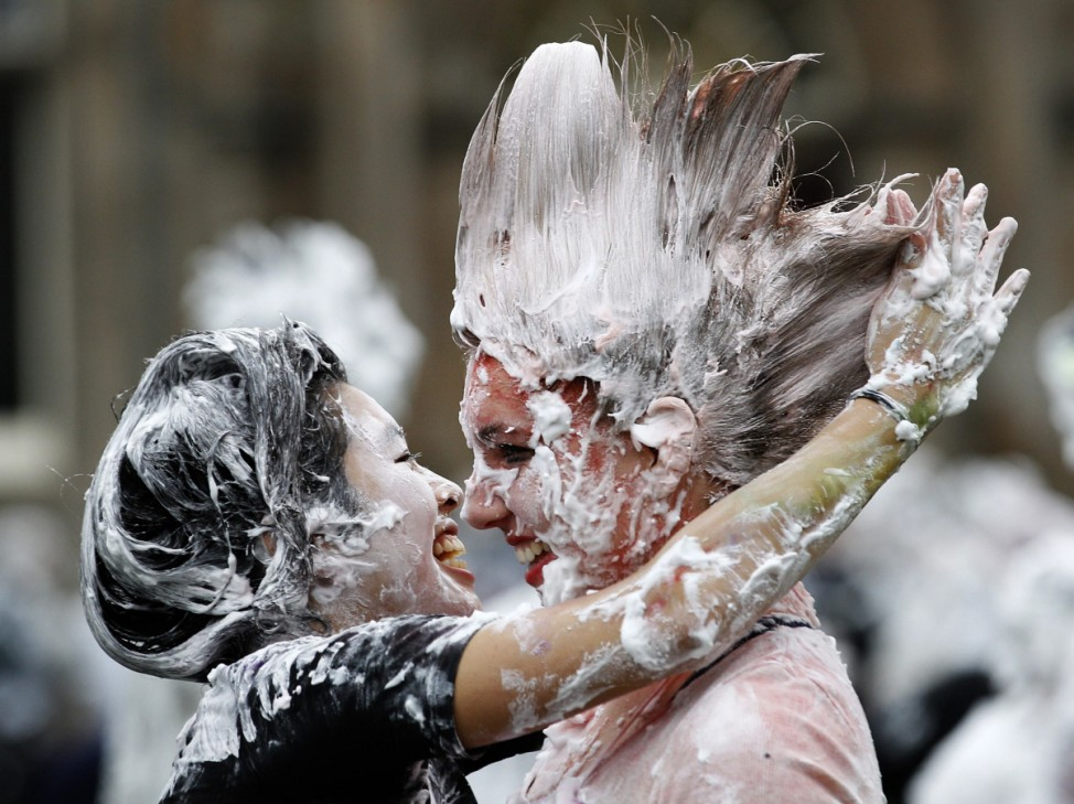 Students from St Andrews University participate in the traditional Raisin Monday celebrations in St Andrews, Scotland