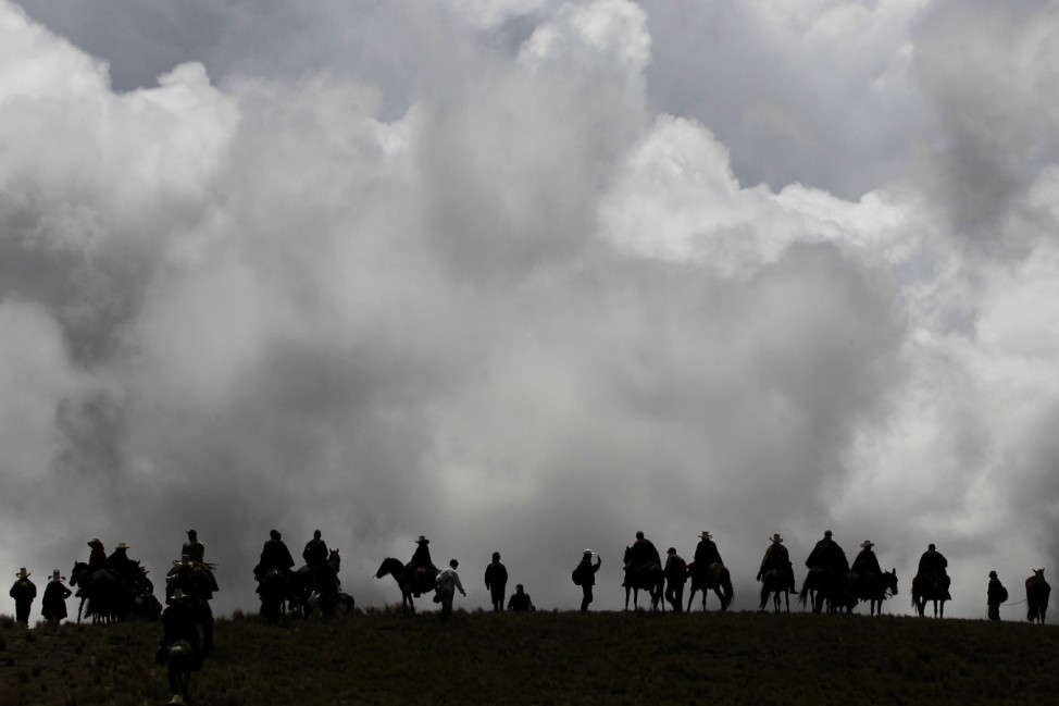 Andean people march during a protest against Newmont's proposed $4.8 billion Conga gold mine, near the Cortada lagoon, in the Andean region of Cajamarca