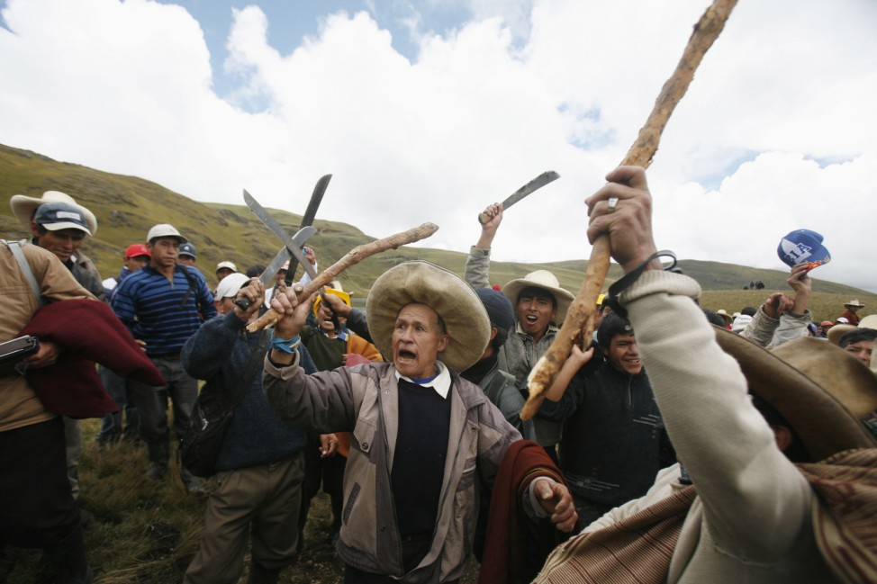 Andean people protest during a march against Newmont's proposed $4.8 billion Conga gold mine, near the Cortada lagoon in Cajamarca
