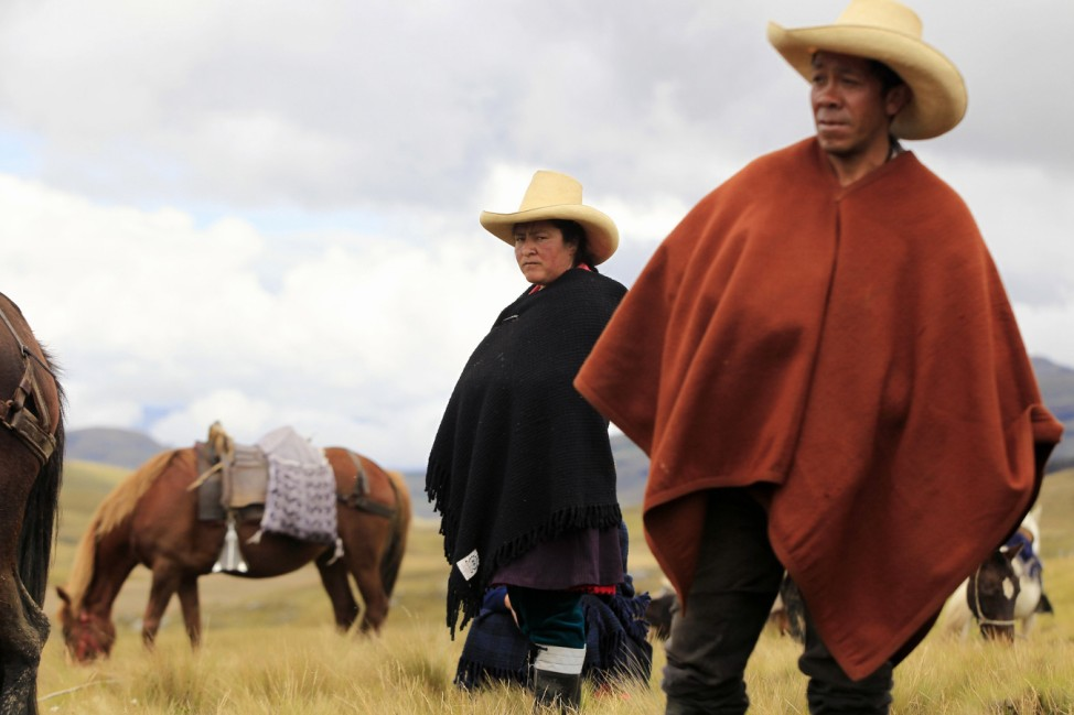 Andean people stand before taking part in a march against Newmont's proposed $4.8 billion Conga gold mine, near the Cortada lagoon in Cajamarca