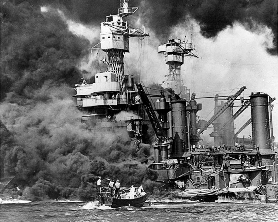 Sailors in a motor launch rush to rescue a survivor in the water alongside USS West Virginia after an attack on Pearl Harbor