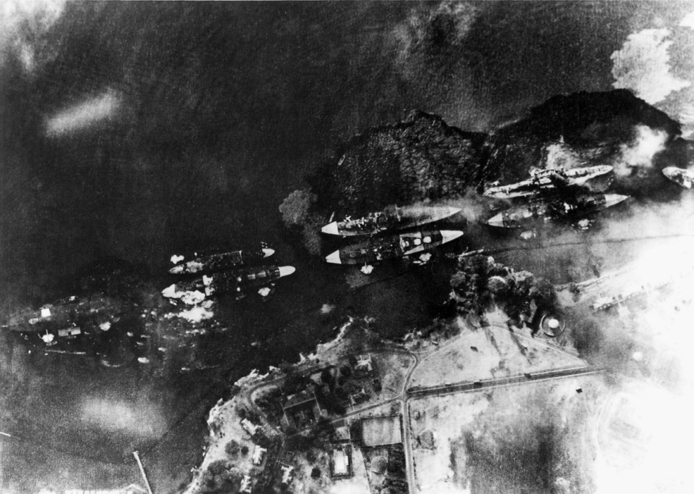 An aerial view of 'Battleship Row' at Pearl Harbor, photographed from a Japanese aircraft, beside Ford Island
