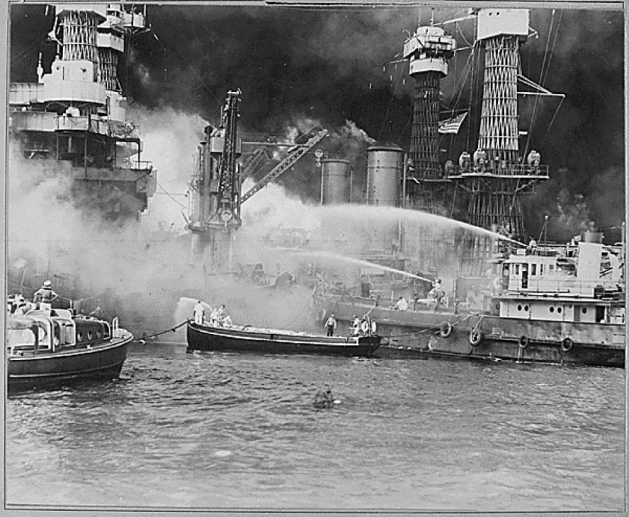 A view of the USS West Virginia in flames in Pearl Harbor, Hawaii