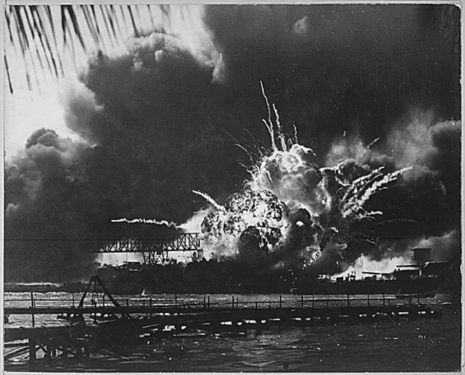 The USS SHAW explodes during the Japanese raid on Pearl Harbor, Hawaii