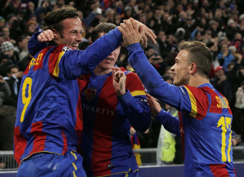 FC Basel's (FCB) Streller and team mates Steinhoefer and Shaqiri react after Streller scored his first goal against Manchester United during their Champions League group C soccer match in Basel