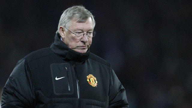 Manchester United's manager Ferguson walks off the pitch after losing against FC Basel during their Champions League Group C soccer match in Basel